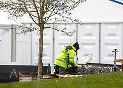 © Licensed to London News Pictures. 30/03/2020. London, UK. Workmen construct new tents which have gone up at Breakspear Crematorium in Ruislip, Hillingdon as Chief aide Dominic Cummings goes into self-isolation after Prime Minister Boris Johnson and Health Secretary Matt Hancock revealled last week that they had contracted coronavirus and are in quarantine as the coronavirus crisis continues. Photo credit: Alex Lentati/LNP