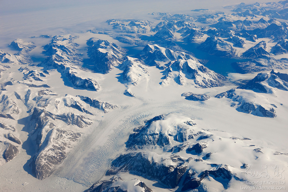 Numerous glaciers carve valleys between the mountains in southeastern Greenland.