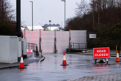 Meadowhall flood defences in place close Meadowhall Drive.  Beyond the flood defences is The Covid-19 testing Station which was also closed as authorities keep a close eye on the swollen River Don around Meadowhall shopping centre in Sheffield. Amber flood alerts remain in place across South Yorkshire due fears that rain brought by Storm Christoph will cause extensive flooding due to a combination of heavy rain fall and already saturated ground<br /> <br /> 20 January 2021<br /> #Photography #Storytelling #PhotoJournalism<br /> If you enjoy my posts and don't want to miss future posts please follow #PhotographyNorth<br />  <br /> All Images Copyright Paul David Drabble -<br /> All rights Reserved -<br /> Moral Rights Asserted -