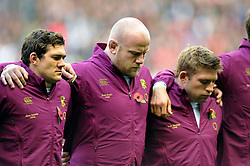 England players Alex Goode, Dan Cole and Tom Youngs observe a minute silence prior to the anthems for Remembrance Sunday - Photo mandatory by-line: Patrick Khachfe/JMP - Tel: Mobile: 07966 386802 09/11/2013 - SPORT - RUGBY UNION -  Twickenham Stadium, London - England v Argentina - QBE Autumn Internationals.