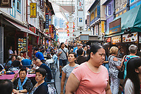 Food stalls along a walking street in Chinatown, Singapore.