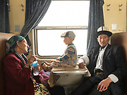 Turdi, a Kyrgyz man wearing traditional hat called Kalpak with his wife Tella Khan (Tella means gold in Turkic language) bring their grand son back to his mother from Yarkand to Kashgar.