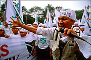 Religion and politics meet on the streets of Jakarta, the convulsed Indonesian capital, where Muslim demonstrators demand jihad, or holy war, against government corruption. Rival groups with radically different visions of Islam – and Indonesia's future – have shaken the most populous island of Java, reflecting a combustible split between rural Muslims known for their religious tolerance and a conservative urban elite. © Steve Raymer 2002 /ALL RIGHTS RESERVED