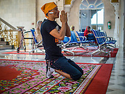 "08 FEBRUARY 2015  BANGKOK, THAILAND:  A man prays in the Darbar Sahib (prayer hall) at Gurdwara Siri Guru Singh Sabha, the Sikh temple in Bangkok. Thailand has a small but influential Sikh community. Sikhs started coming to Thailand, then Siam, in the 1890s. There are now several thousand Thai-Indian Sikh families. Gurdwara Siri Guru Singh Sabha was established in 1913. Construction of the current building, adjacent to the original Gurdwara (""Gateway to the Guru""), started in 1979 and was finished in 1981. The Sikh community serves a daily free vegetarian meal at the Gurdwara that is available to people of any faith and background.   PHOTO BY JACK KURTZ"