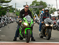 Riders sporting Kawasaki Ninja's ZX 10R and a ZX 6R 636 head down Lakeside Avenue into Weirs Beach on Thursday afternoon.  (Karen Bobotas/for the Laconia Daily Sun)