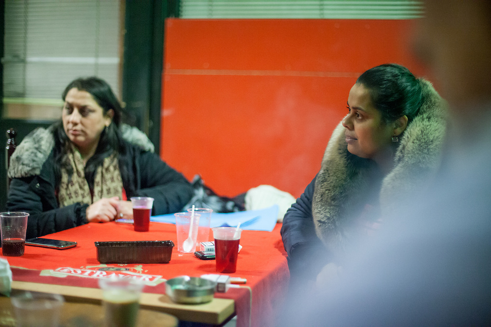 Volunteer Anastazie Baudycka (28, right) during a meeting with volunteers for data collection regarding school enrolments in a backroom of a bar in Ostrava.