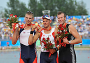 Shunyi, CHINA. right, Bronze medalist NZL 1X, Mahe DRYSDALE, Gold Medalist NOR M1X Olaf TUFTE and Sliver medalist, CZE M1X, Ondrej SYNEK, men's single, at the 2008 Olympic Regatta, Shunyi Rowing Course.  Sat,.16.08.2008.  [Mandatory Credit: Peter SPURRIER, Intersport Images