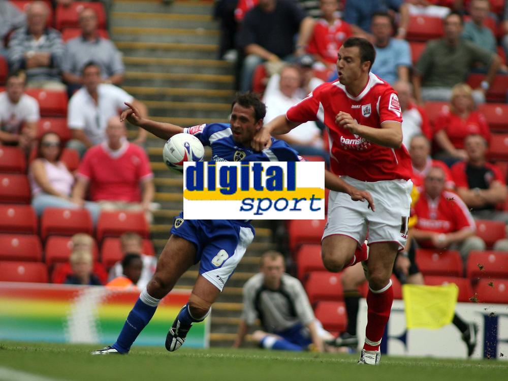 Photo: Rich Eaton.<br /> <br /> Barnsley v Cardiff City. Coca Cola Championship.<br /> <br /> 05/08/2006. Michael Chopra for Cardiff and Barnsleys Antony Kay go for the ball