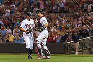 Glen Perkins #15 and Joe Mauer #7 of the Minnesota Twins celebrate after the Twins defeated the Philadelphia Phillies on June 11, 2013 at Target Field in Minneapolis, Minnesota.  The Twins defeated the Phillies 3 to 2.  Photo: Ben Krause