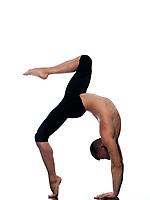 caucasian man stretching gymnastic acrobatics isolated studio on white background
