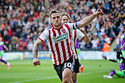 Sheffield Utd forward Billy Sharp (10) celebrates his opening goal 1-0 during  the EFL Sky Bet Championship match between Sheffield United and Bristol City at Bramall Lane, Sheffield, England on 30 March 2019.