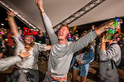The silent disco is full pof people dancing with headphones on - every so often there a a coordinated burst of singing as dancers reach a chorus but never any music - The 2016 Glastonbury Festival, Worthy Farm, Glastonbury.