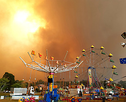 Batemans Bay New Years Eve bushfires in Australia on december 31, 2019. Witness commentary : It was upon us without warning; the night before I walked through the beach carnival and could see the fire in the mountains in the distance. I had a terrible feeling that everything might go to hell, and that the people screaming and laughing on the rides, and winning prizes in the sideshow alley, had no idea what was in store... I had a knock on my hotel door early morning that the fire front was rapidly approaching.I ran to the beach, and handed out the spare P2 masks I'd bought just the day before. People were terrified, huddled together, trying to take shelter on the beach. Then the bush on the beach caught fire, the sky was deepening red and black, and I ran back to my hotel room to take shelter from the heat. It was like being in the centre of hell.Photo by Megan Juresa/ABACAPRESS.COM