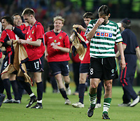 """PORTUGAL - LISBOA 18 MAY 2005:  PEDRO BARBOSA  #8 crying after Sporting lost the match for the final in the UEFA Cup Final, match Sporting CP (1) vs CKA Moscow (3), held in """"Alvalade 21"""" stadium,  18/05/2005  21:44:51<br />(PHOTO BY: GERARDO SANTOS/AFCD)<br /><br />PORTUGAL OUT, PARTNER COUNTRY ONLY, ARCHIVE OUT, EDITORIAL USE ONLY, CREDIT LINE IS MANDATORY AFCD-PHOTO AGENCY 2004 © ALL RIGHTS RESERVED"""