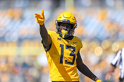 Sep 18, 2021; Morgantown, West Virginia, USA; West Virginia Mountaineers wide receiver Sam James (13) celebrates a first down during the second quarter against the Virginia Tech Hokies at Mountaineer Field at Milan Puskar Stadium. Mandatory Credit: Ben Queen-USA TODAY Sports