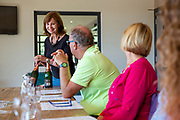A female tour guide discusses and displays a bottle of Balfour Brute Rose wine to a group of visitors at Hush Heath Winery, Staplehurst, Kent, England, UK.  (photo by Andrew Aitchison / In pictures via Getty Images)
