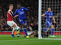 Football - 2018 / 2019 Premier League - Arsenal vs. Leicester City<br /> <br /> Harry Maguire of Leicester has his header saved by Arsenal goalkeeper, Bernd Leno,as Wilfred Ndidi follows up at The Emirates.<br /> <br /> COLORSPORT/ANDREW COWIE
