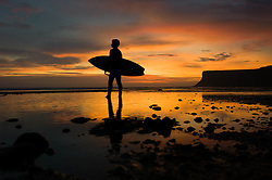 © Licensed to London News Pictures. 27/08/2012..Saltburn Beach, Cleveland, England..A surfer at Saltburn beach in Cleveland enjoys an amazing sunrise as he prepares to go for a morning surf...Photo credit : Ian Forsyth/LNP