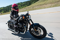 Iron Lily Leticia Cline on the Harley-Davidson Angels Ride to benefit the Nature Conservancy during the annual Sturgis Black Hills Motorcycle Rally.  SD, USA.  August 12, 2016.  Photography ©2016 Michael Lichter.