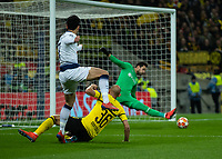 Football - 2018 / 2019 UEFA Champions League - Round of Sixteen, First Leg: Tottenham Hotspur vs. Borussia Dortmund<br /> <br /> Roman Burki (Borussia Dortmund) saves with his feet from Heung-Min Son (Tottenham FC) at Wembley Stadium.<br /> <br /> COLORSPORT/DANIEL BEARHAM
