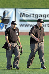 17 August 2013:  Umpires Chuck Adya and T.J. Cunningham walk across the field during a Frontier League Baseball game between the Rockford Aviators and the Normal CornBelters at Corn Crib Stadium on the campus of Heartland Community College in Normal Illinois