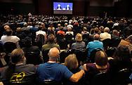 Berkshire Hathaway shareholders in an overflow room watch the Berkshire Hathaway annual meeting on a TV screen in Omaha, Nebraska, U.S. May 6, 2017. REUTERS/Rick Wilking