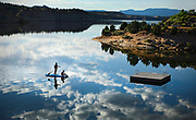 SHOT 6/29/17 7:29:51 AM - Heather Holt, 19, of Fort Collins, Co. and Lexi Coltharp, 11, of Vernal, Utah stand up paddle board on the reservoir in Red Fleet State Park. Red Fleet State Park is a state park in Utah featuring a 750-acre reservoir and a fossil trackway of dinosaur footprints. The park is located 10 miles north of Vernal. Vernal, the county seat and largest city in Uintah County is in northeastern Utah, United States, about 175 miles east of Salt Lake City and 20 miles west of the Colorado border. As of the 2010 census, the city population was around 9,000 people. (Photo by Marc Piscotty / © 2017)