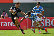 Brilliant side step & fend by Joe Webber sets him up for New Zealand's 2nd try against Argentina during day one at the Emirates Airline Dubai Rugby Sevens 1st December 2017.<br /> Copyright photo: Tom Kirkwood / www.photosport.nz
