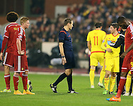 Wales' Joe Allen receives treatment after a clash with Belgium's Marouane Fellaini<br /> <br /> - European Qualifier - Belgium vs Wales- Heysel Stadium - Brussels - Belgium - 16th November 2014  - Picture David Klein/Sportimage