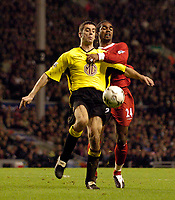 Photo. Jed Wee.<br /> Liverpool v Aston Villa, FA Barclaycard Premiership, Anfield, Liverpool. 10/01/2004.<br /> Liverpool's Florent Sinama-Pongolle (R) grapples with Villa's Mark Delaney for possession.