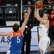 Anadolu Efes's Sinan Guler (R) during their Turkish Basketball League match Anadolu Efes between Mersin BSB at Sinan Erdem Arena in Istanbul, Turkey, Saturday, January 14, 2012. Photo by TURKPIX