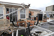 Homeowner Joe Lovece surveys the damage to the kitchen at the back of his oceanfront home after the eye of Hurricane Matthew passed Ormond Beach, Florida, U.S. October 7, 2016. Lovece rode out the storm as waves took away the room at the back of his home.  (Photo by Phelan M. Ebenhack)