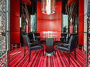 """29 JANUARY 2016 - BANGKOK, THAILAND: The """"crystal room"""" one of the private dining rooms at L'atelier de Joel Robuchon, an exclusive French restaurant owned by French chef Joel Robuchon. The restaurant features counter style seating which looks into the kitchen so diners can watch the chefs work.          PHOTO BY JACK KURTZ"""