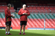 Wales head coach Warren Gatland ® and assistant coach Rob Howley look on during the Wales rugby captains run training session at the Millennium Stadium in Cardiff ,South Wales on Friday 4th Sept  2015. The team are preparing for their next RWC warm up match against Italy tomorrow.  pic by Andrew Orchard, Andrew Orchard sports photography.