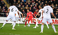 Raheem Sterling of Liverpool © looks for a way through as he finds himself surrounded by the Swansea city defence. Barclays Premier League, Swansea city v Liverpool at the Liberty stadium in Swansea, South Wales on Monday 16th March 2015.<br /> pic by Andrew Orchard,