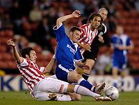 Photo: Glyn Thomas.<br />Stoke City v Cardiff City. Coca Cola Championship.<br />27/09/2005.<br /> Stoke's Carl Hoefkens (L) slides in to tackle Cardiff's Jason Koumas.