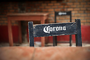 """SHOT 2/6/20 5:25:01 PM - A Corona beer branded chair and tables at a restaurant in Sayulita, Mexico. Sayulita is a small fishing village about 25 miles north of downtown Puerto Vallarta in the state of Nayarit, Mexico, with a population of approximately 4,000. Known for its consistent river mouth surf break, roving surfers """"discovered"""" Sayulita in the late 60's with the construction of Mexican Highway 200. In recent years, it has become increasingly popular as a holiday and vacation destination, especially with surfing enthusiasts and American and Canadian tourists. (Photo by Marc Piscotty / © 2020)"""