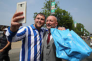 Ian Holloway poses for a selfie with a Sheffield Wednesday fan outside Wembley Stadium before k/o. Skybet football league Championship play off final match, Hull city v Sheffield Wednesday at Wembley Stadium in London on Saturday 28th May 2016.<br /> pic by John Patrick Fletcher, Andrew Orchard sports photography.