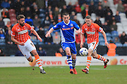 Donal McDermott, Jim McAlister, Clark Robertson during the Sky Bet League 1 match between Rochdale and Blackpool at Spotland, Rochdale, England on 16 April 2016. Photo by Daniel Youngs.