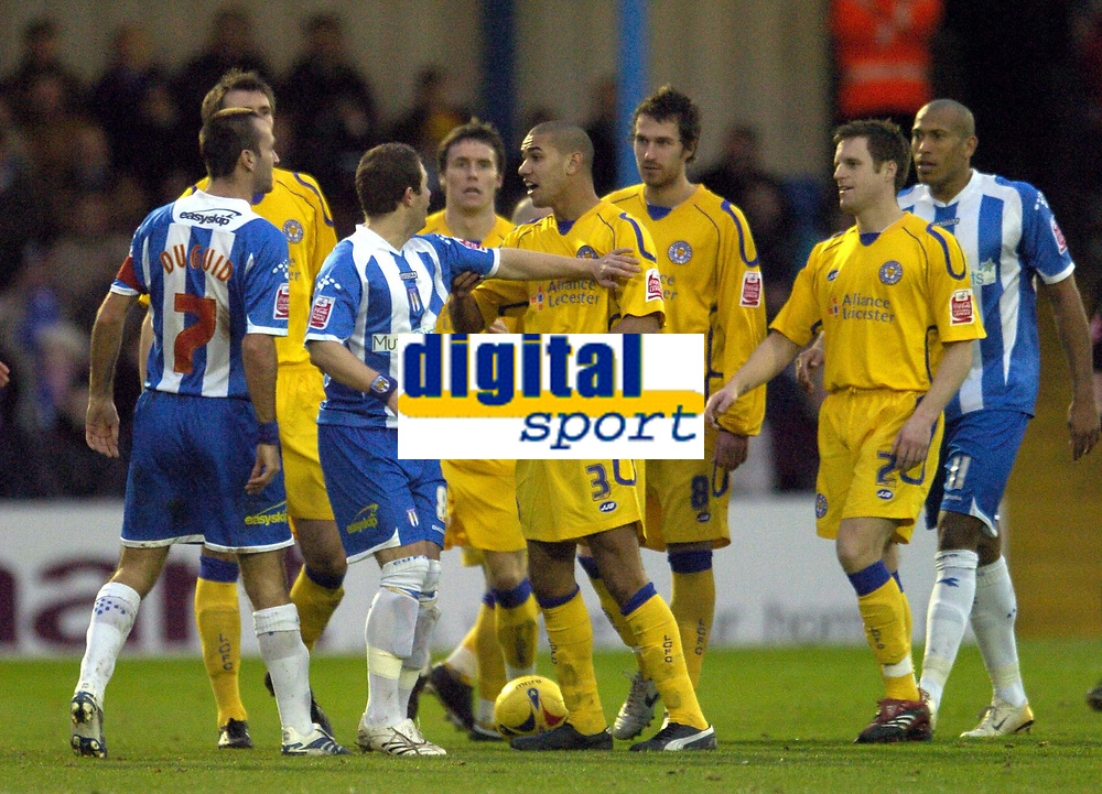 Photo: Olly Greenwood.<br />Colchester United v Leicester City. Coca Cola Championship. 13/01/2007. Colchester's Karl Duguid and Leicester's Patrick Kisnorbo have to be kept apart