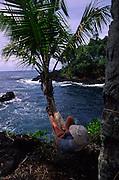 Reading in Hammock, Hana Coast, Maui, Hawaii<br />