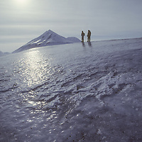 Polar travelers explore icy serac on glacier near Svea.