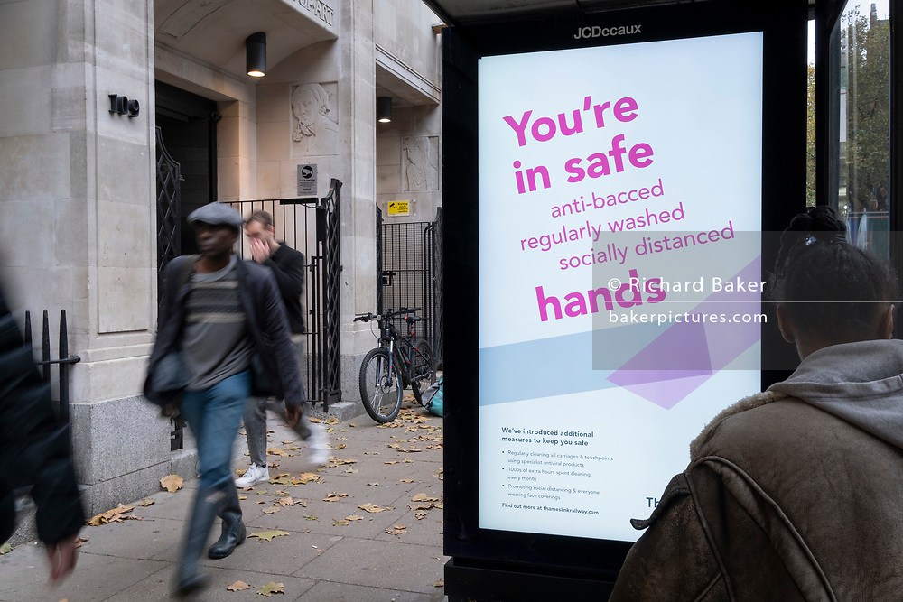 An ad by rail operator Thameslink urges passengers and the wider public to maintain hand hygiene by using anti-viral hand gels, during the second wave of the UK Coronavirus pandemic, on 30th October 2020, in London, England.