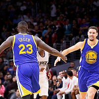 19 November 2015: Golden State Warriors guard Klay Thompson (11) is congratulated by Golden State Warriors forward Draymond Green (23) during the Golden State Warriors 124-117 victory over the Los Angeles Clippers, at the Staples Center, Los Angeles, California, USA.