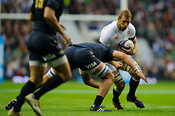 England Flanker (#7) Chris Robshaw (Harlequins, capt) is tackled by Argentina Lock (#5) Patricio Albacete (Toulouse) during the first half of the match - Photo mandatory by-line: Rogan Thomson/JMP - Tel: Mobile: 07966 386802 09/11/2013 - SPORT - RUGBY UNION -  Twickenham Stadium, London - England v Argentina - QBE Autumn Internationals.