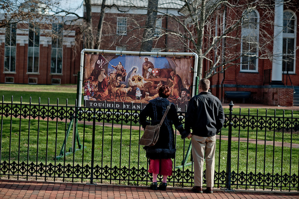 A couple passing by looks at objects on display in the courtyard at the Loudoun County courthouse on Sunday, December 18th, 2011 in Leesburg, Va.  (Photo by Jay Westcott for The Daily)