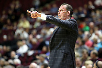 Florida Gulf Coast University's head coach Joe Dooley calls out plays to his team during a NCAA college basketball game against Texas A&M in College Station, Texas, Wednesday, Dec. 2, 2015.  (AP Photo/Sam Craft)