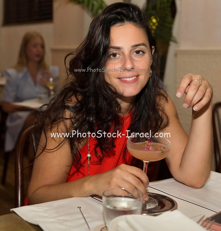 Lifestyle concept. Young woman in an atmospheric, posh restaurant