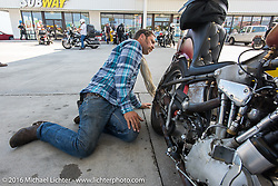 Sean Duggan looking over his 1936 Harley-Davidson Knucklehead at a gas stop during Stage 3 of the Motorcycle Cannonball Cross-Country Endurance Run, which on this day ran from Columbus, GA to Chatanooga, TN., USA. Sunday, September 7, 2014.  Photography ©2014 Michael Lichter.