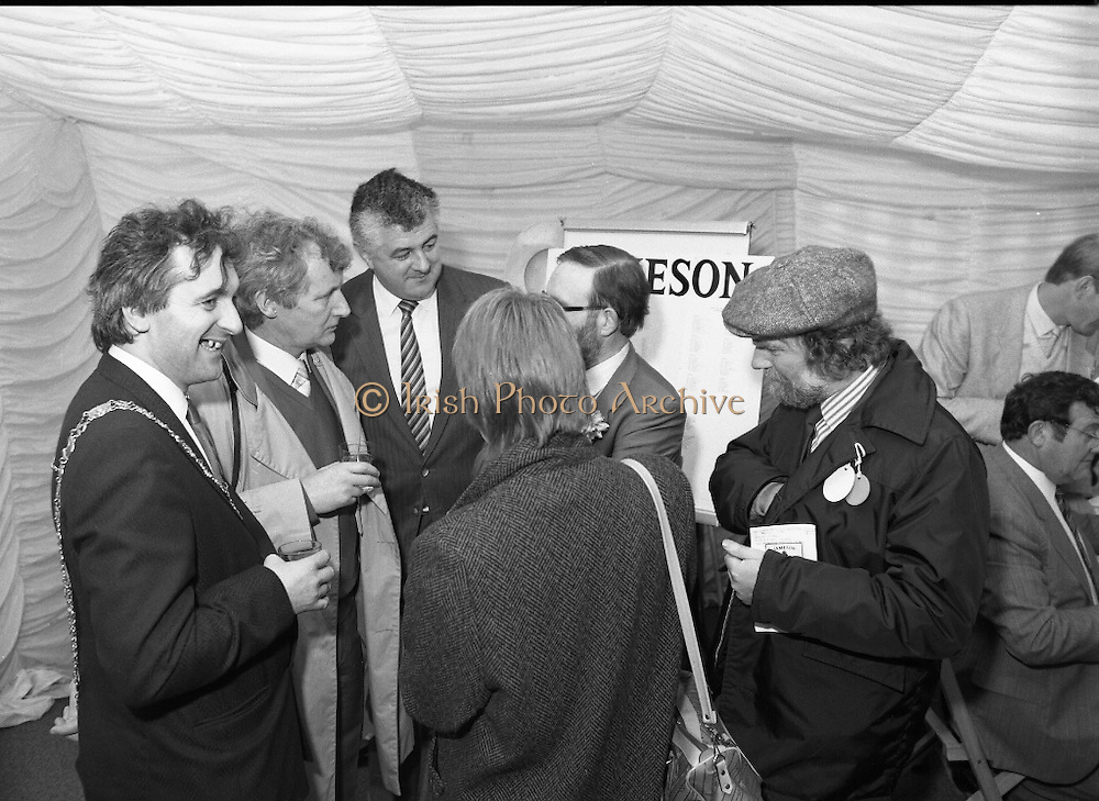Irish Grand National At Fairyhouse.  (R54)..1987..20.04.1987..04.20.1987..20th April 1987..The Easter Racing Festival at Fairyhouse included the running of the Jameson sponsored Irish Grand National. Another featured race was the Jameson Gold Cup which was also run on Easter Monday...In the sponsors tent,winning owner, Mr Jimmy Glynn celebrates his win with a glass of Jameson Whiskey. Included in the picture are Mr Bertie Ahern,Lord Mayor of Dublin, Mr Richard Burrows, Group Managing Director, Irish Distillers and members of the racing fraternity